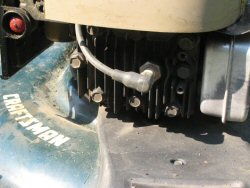 spark plug with spark plug wire on a craftsman lawnmower