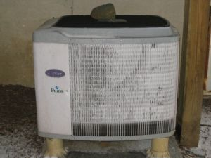 iced over heat pump compressor unit