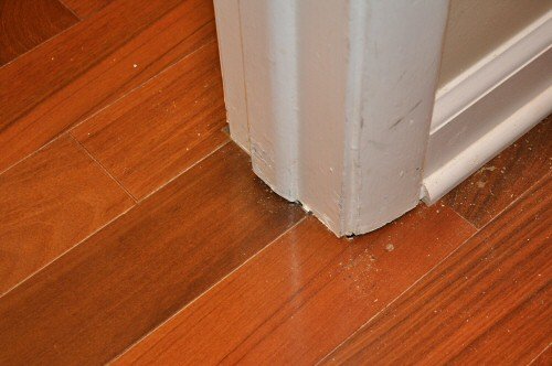 door-trim-sitting-over-wood-floors - Cut Door Trim And Stops For Hardwood Flooring Installation In