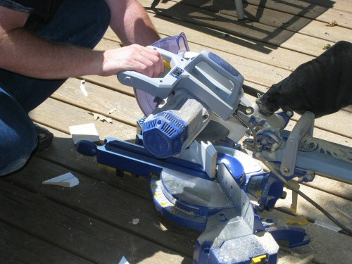 mitre-saw-cutting-baseboard