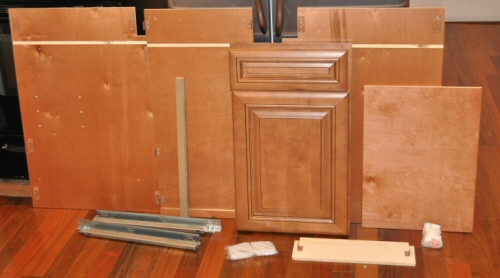solid wood ipc cabinet components laid out on a kitchen floor