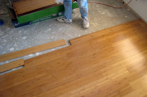 One challenge with a floating wood floor is that previous rows can shift  after they're laid. For this reason it's important go back and tighten up  joints ... - We Installed A Bamboo Floating Floor With Habitat, Tuscaloosa