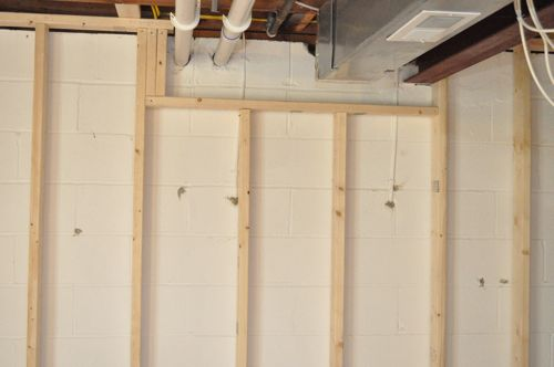 How To Frame A Basement Wall finishing a basement, day 1: framing the walls - one project closer