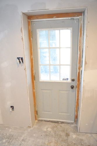 door off its hinges and removing the door casing and brick molding