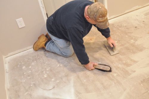Step 3: Sponge Clean - How To Level A Subfloor Before Laying Tile - One Project Closer