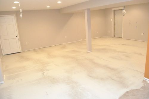 How to level a subfloor before laying tile one project for Concrete floor leveling