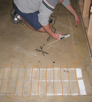 How to install electric radiant heating wire on a cement - How do heated bathroom floors work ...