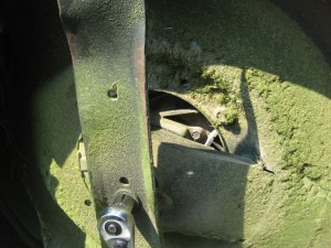Underside of mower, removing blade