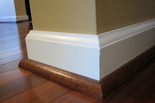 Round On A Ceramic Vinyl Or Stone Tile Floor You Should Paint The Quarter To Match Baseboard Molding Most Common Trim Color Is White