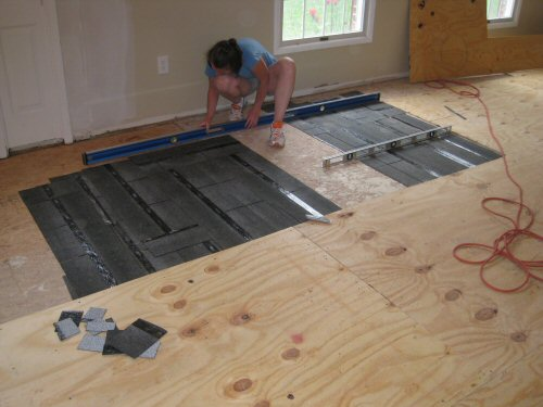 How To Level A Plywood Or OSB Subfloor Using Asphalt Shingles - Install vinyl flooring over plywood subfloor