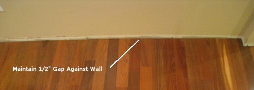 maintain gap between hardwoods and wall