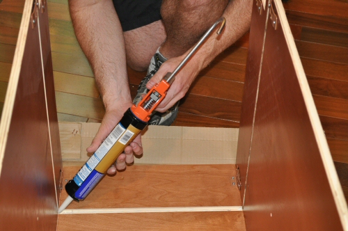 use construction adhesive on the cabinets