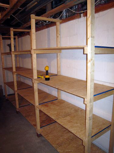 How to build inexpensive basement storage shelves one for Cheapest way to build a building