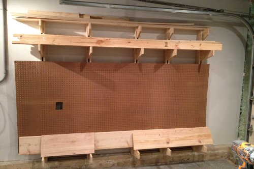 diy wall storage how to build a wall mounted lumber storage rack one project closer
