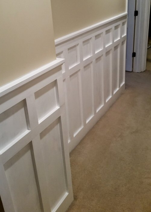 Board and Batten Painted White Down Hallway