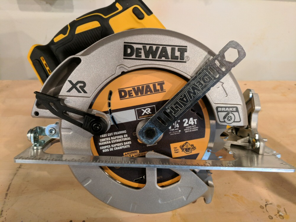 Dewalt 20v li ion brushless 7 14 circular saw w brake review heres a picture of how the blade change wrench stores beneath the battery receiver in the back of the tool pretty convenient keyboard keysfo Images